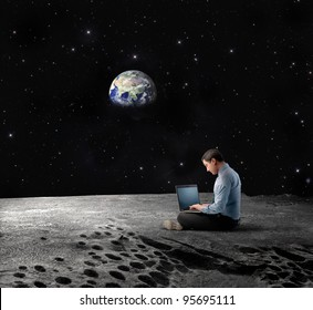 "Businessman sitting on the Moon and using a laptop with Earth in the background ""Elements of this image furnished by NASA"""