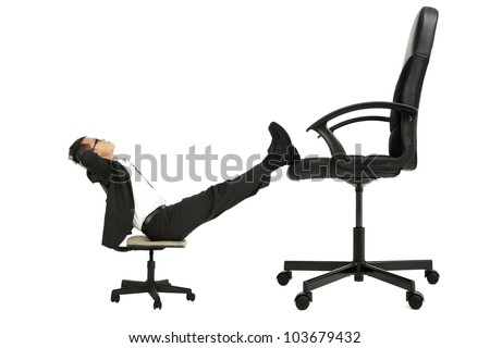 Businessman Sitting On Small Chair Leg Stock Photo Edit Now