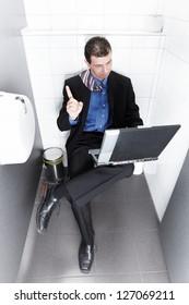 businessman sitting on the toilet having an idea