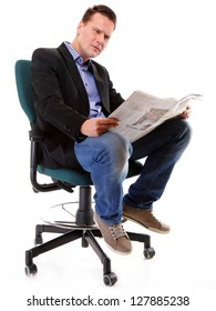 Businessman sitting and reading a newspaper isolated on white background