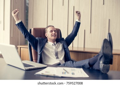 Businessman sitting with relax feeling at office, Man finishing up a work, Man with Leader Concept. Vintage tone.