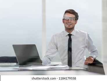 businessman sitting in a spacious office