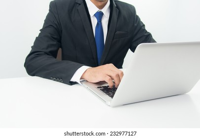 Businessman Sitting Working on Laptop on white background