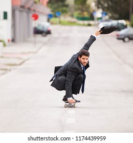 Businessman skateboarding at the street