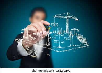 Businessman sketching a construction project.