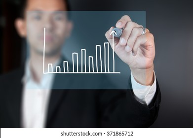 Businessman sketching diagram of changes of market
