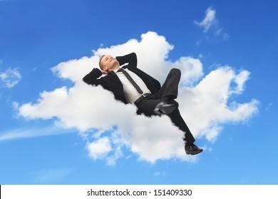 Businessman sleeping in a cloud