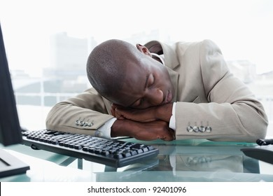 Businessman sleeping on his desk in his office