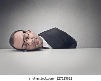 businessman sleeping on the table