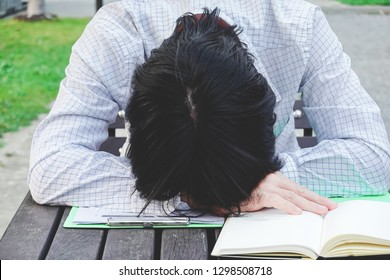 Businessman sleeping on work wooden desk, work hard and tired concept