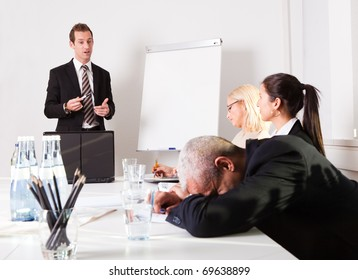 Businessman sleeping at the presentation