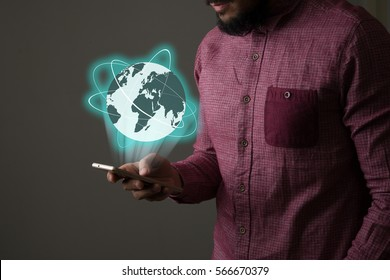 Businessman with smartphone and Global network on screen interface. Business technology concept.