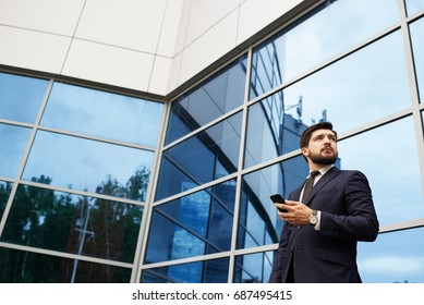Businessman with smartphone in hand