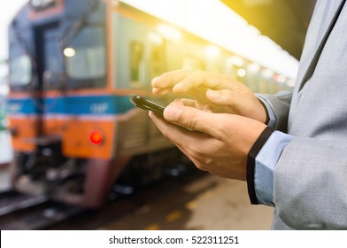 Businessman with Smartphone or Mobile Phone, Waiting at the Train Platform Station - business, technology, navigation and people concept