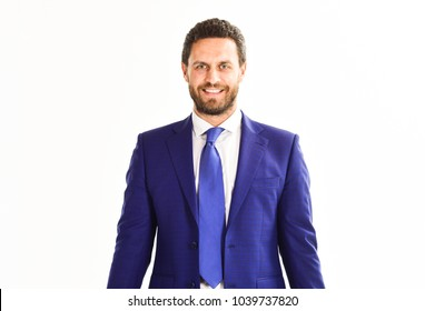Businessman with smiling face wears classic suit and tie. Man in suit or businessman with beard on white background. Business and people concept. Businessman with unshaven face and happy expression.