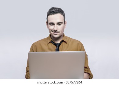 Businessman smiling in front of a lap top