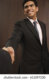 Businessman smiling and shaking hands