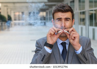 Businessman smoking four cigarettes simultaneously