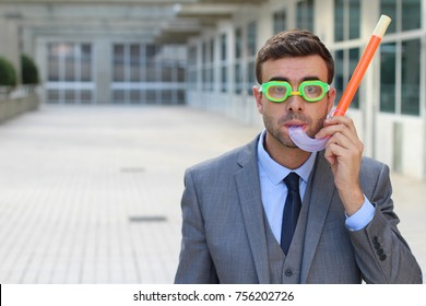 Businessman with snorkeling equipment isolated