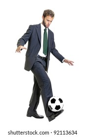 Businessman with soccer ball isolated in white