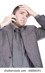 businessman speaking on the phone and looking worried