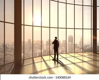 businessman speaking at sunset office