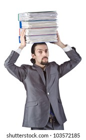 Businessman with stack of folders