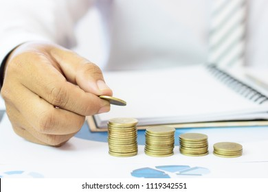 businessman stacked money coins on paper work , success, finance and capital banking concept