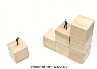 Businessman and Stairs of square blocks. (on white background)