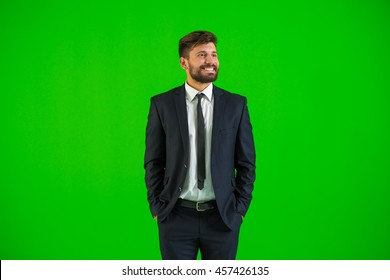 The businessman stand on the green background