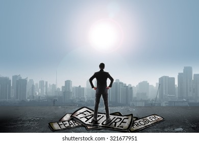 Businessman stand on problem traffic sign looking at sun, success concept