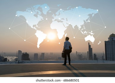 Businessman stand on roof top of building,  globalization conceptual
