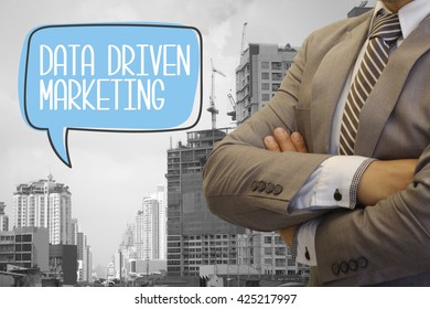 businessman stand with speech bubble DATA DRIVEN MARKETING text