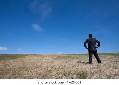 businessman standing alone at the field