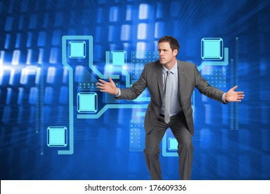 Businessman standing with arms out against glowing squares on blue background