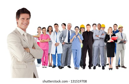 Businessman standing in front of different types of workers on white background