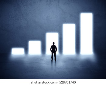 Businessman standing in the front of growth chart of profits