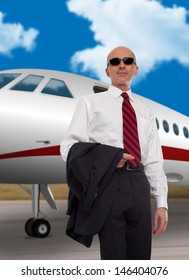 Businessman standing in front of a private plane