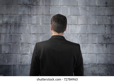 Businessman standing in front of a wall