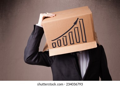 Businessman standing and gesturing with a cardboard box on his head with diagram