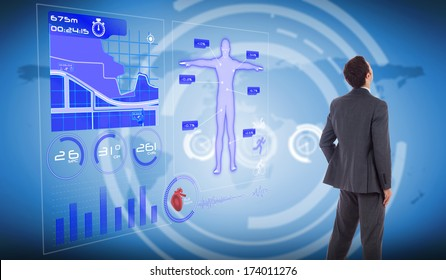 Businessman standing with hand on hip against international business interface