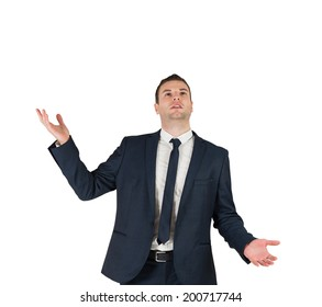 Businessman standing with hands outstretched on white background