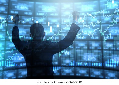 Businessman standing happy expression in front of digital electronic trading screen