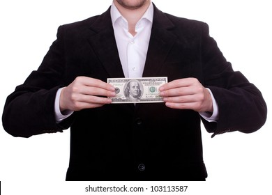 Businessman standing with a hundred american dollars in his hands