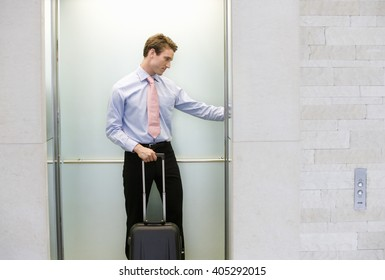 A businessman standing in a lift