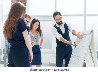 businessman standing near the flipchart in the conference room