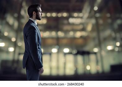 Businessman standing next to an apartment window