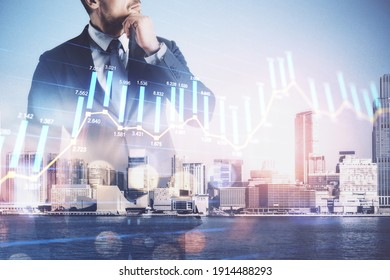 Businessman standing on abstract city background with stock infographic on virtual screen. Growth and career development concept. Multiexposure