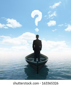 businessman standing on a boat with question mark