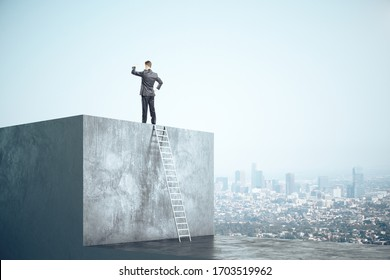 Businessman standing on concrete cube with ladder and look into the distance on city background. Motivation and career success concept